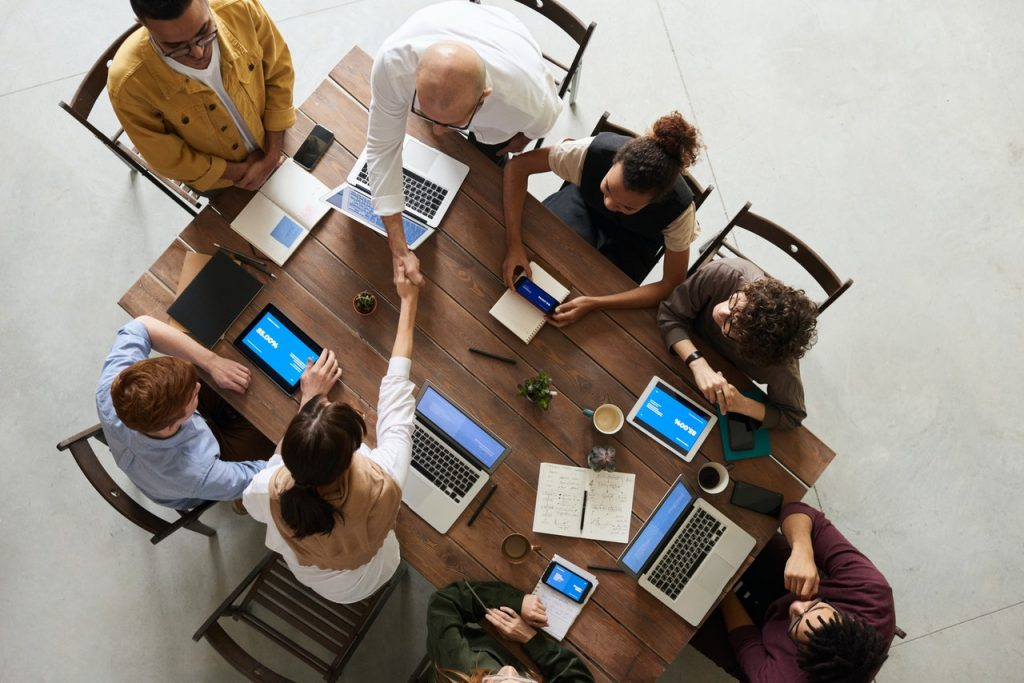 people in business meeting using innovative technology