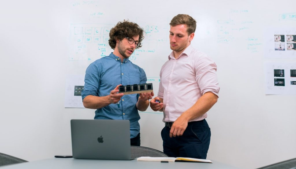 two guys talking about technology