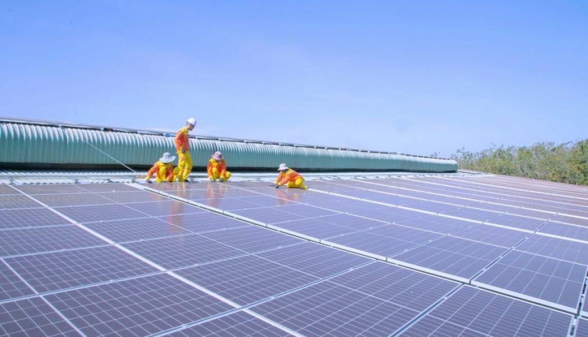 men putting in solar panels